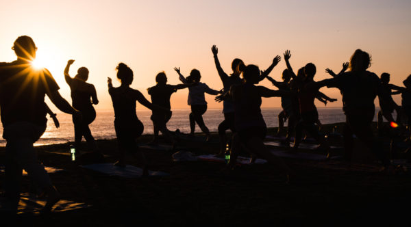 500px Photo ID: 135211595 - Silhouette of people doing yoga at sunset at the beach.